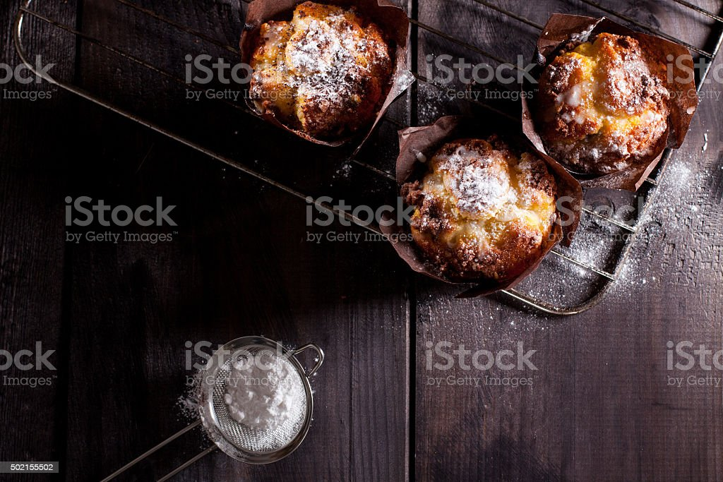 Muffins on wooden background. stock photo