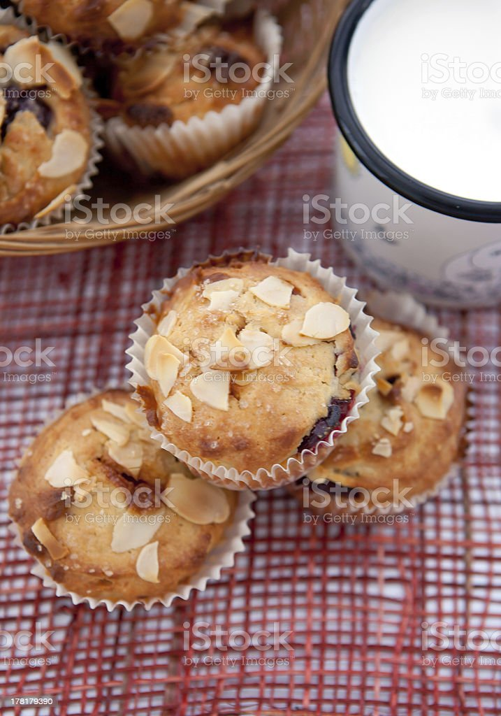 Muffins with almonds, cherries and milk, top view royalty-free stock photo