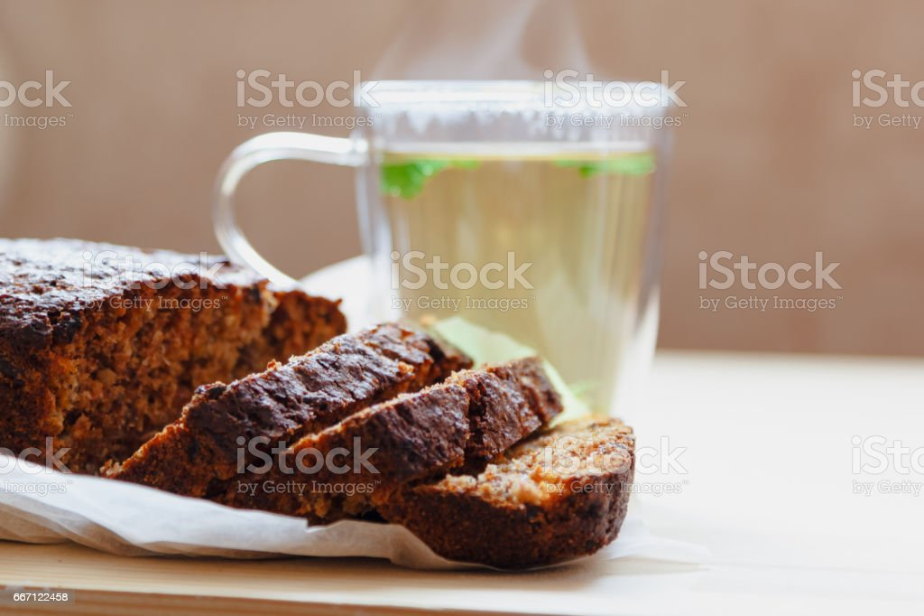 Muffins with dried fruit and a cup of green tea. stock photo