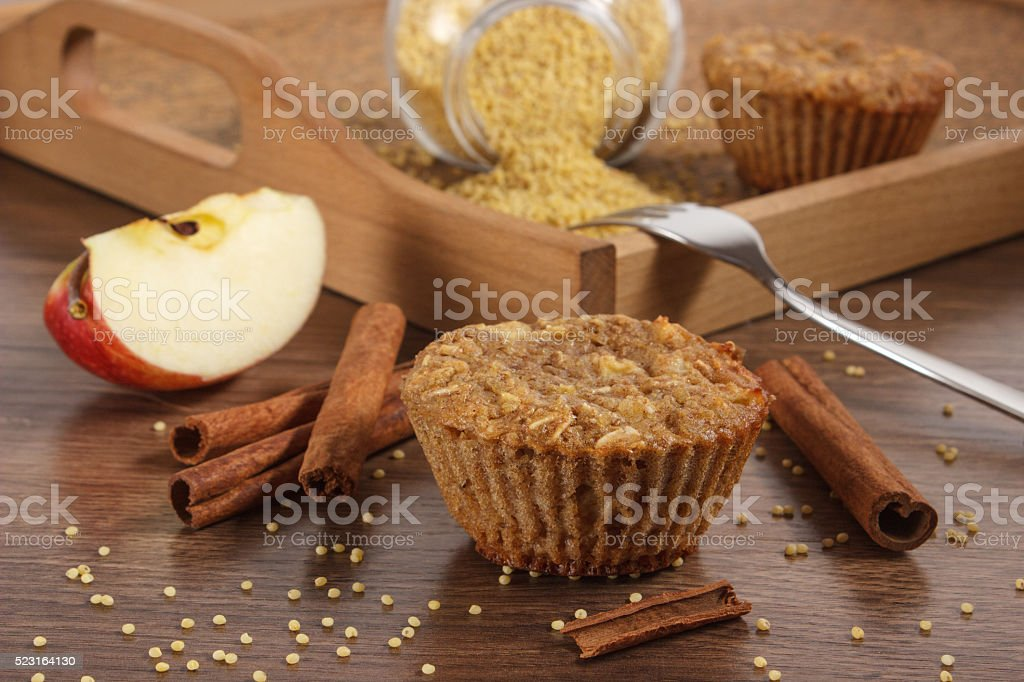 Muffins with millet groats, cinnamon and apple, delicious healthy dessert stock photo