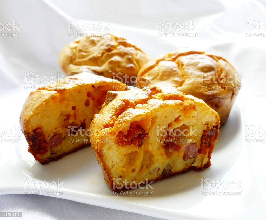 Muffins with sausage, cheese and bacon stock photo