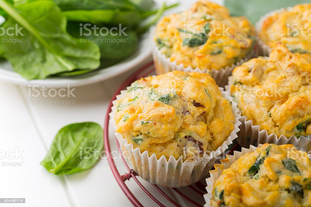 Muffins with spinach, sweet potatoes and cheese stock photo
