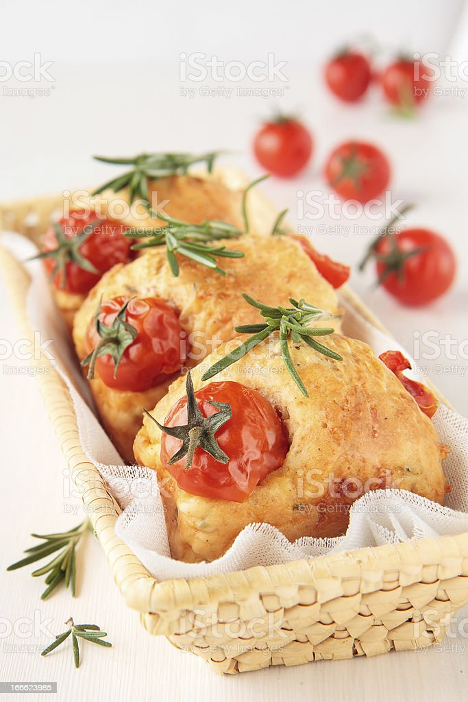 Muffins with tomato and rosemary in basket royalty-free stock photo