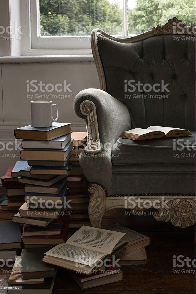 mug and pile of books  stock photo