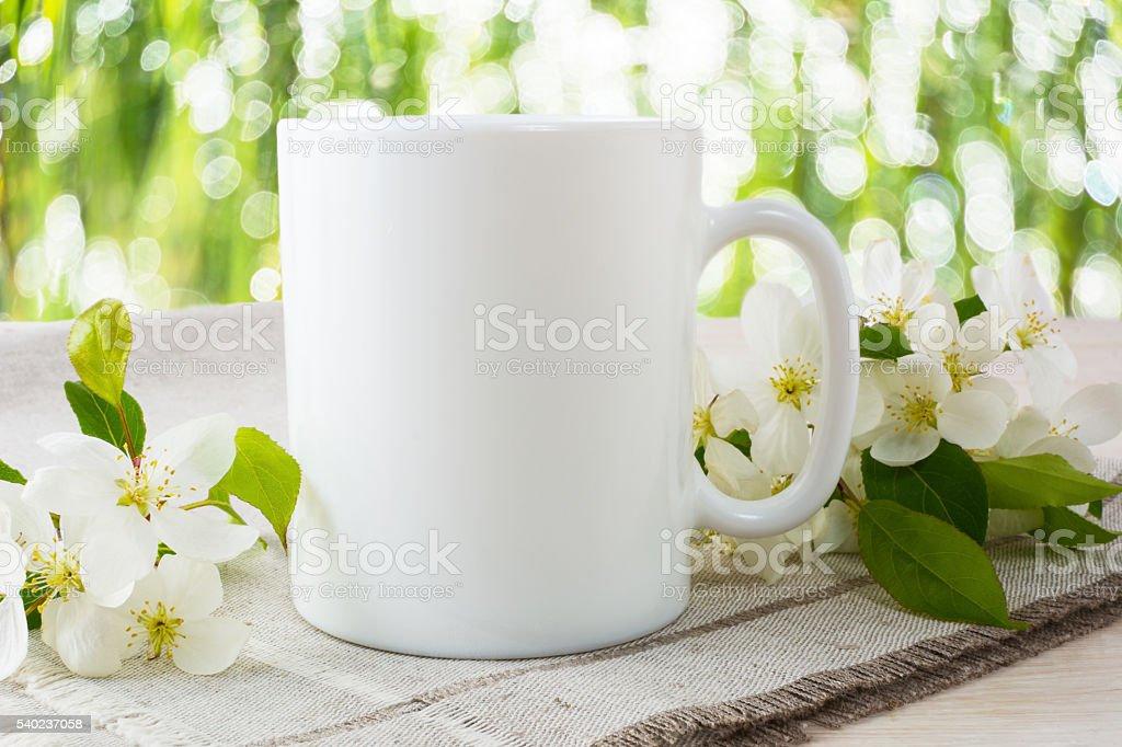 Mug mockup with apple blossom stock photo