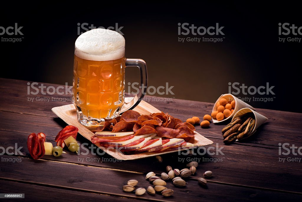 Mug of beer with snacks stock photo