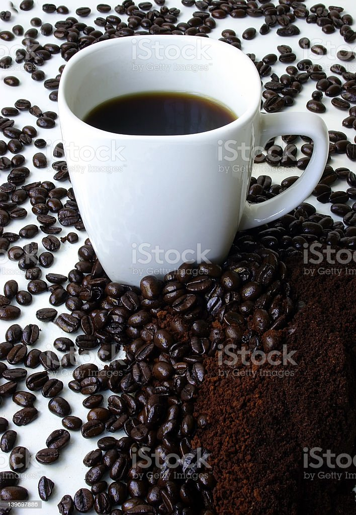 Mug of Coffee Surrounded by Coffee Beans royalty-free stock photo