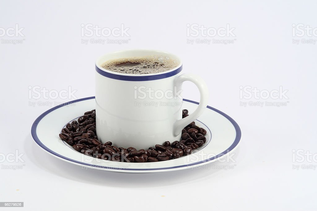 Mug Of Coffee With Beans On The Saucer stock photo