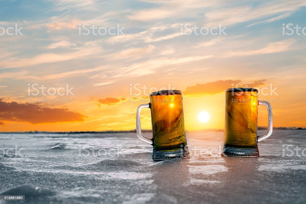 Mug of Cold Beer at Sunset stock photo