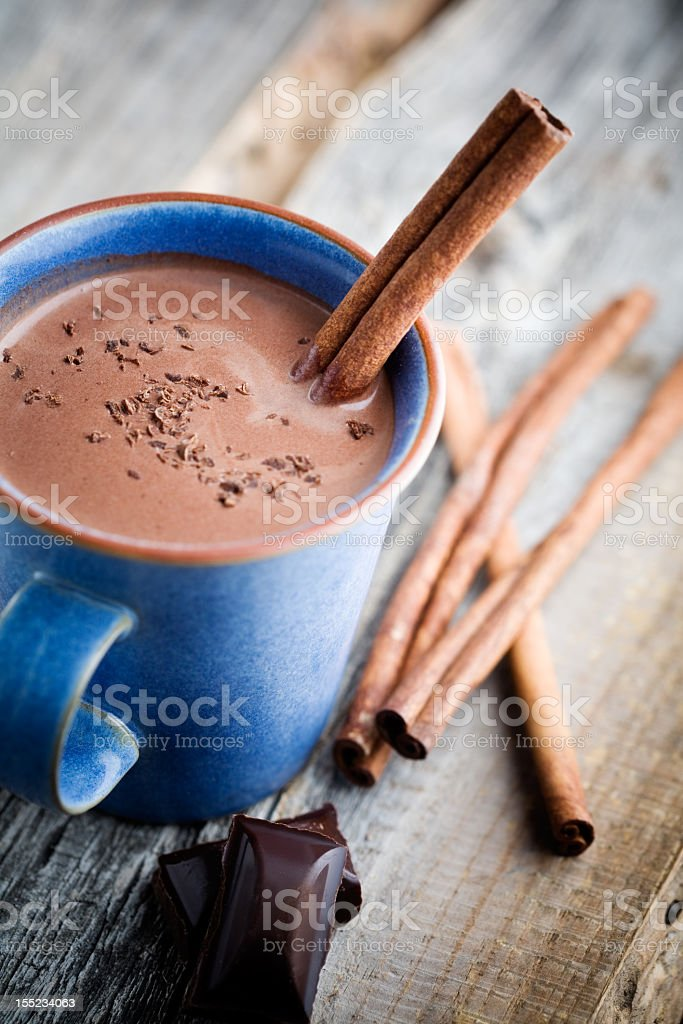 Mug of hot chocolate with cinnamon sticks royalty-free stock photo