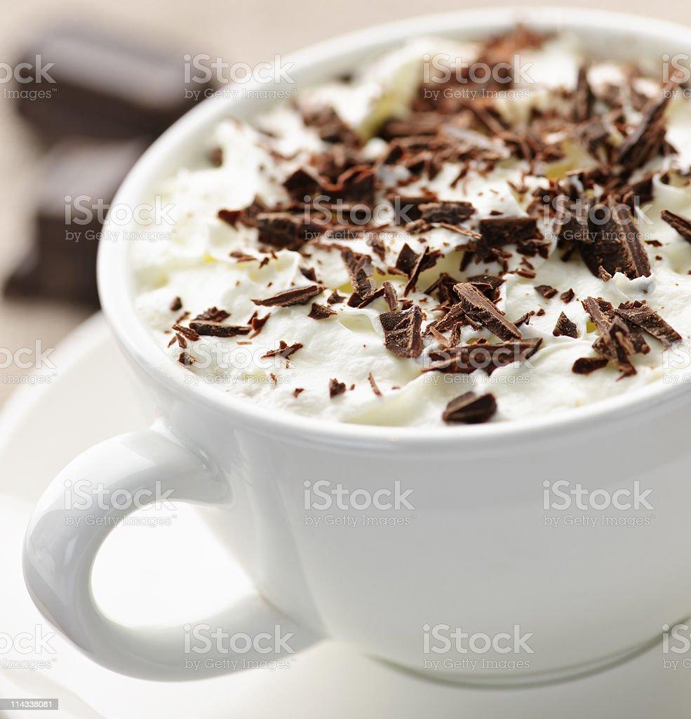 Mug of hot chocolate with cream and chocolate shavings royalty-free stock photo