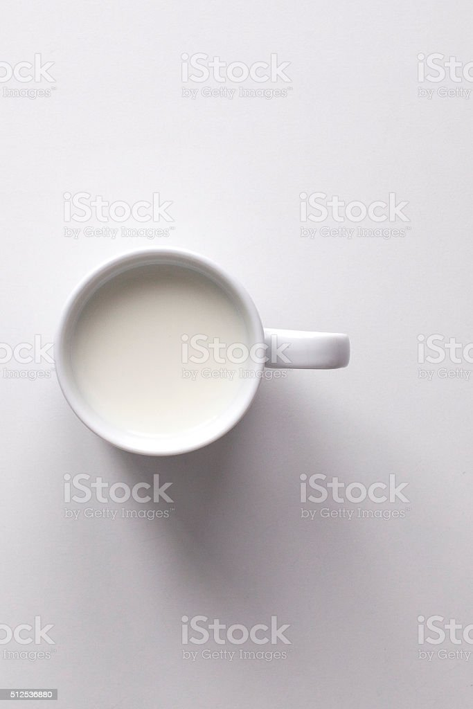 Mug of milk on white background stock photo