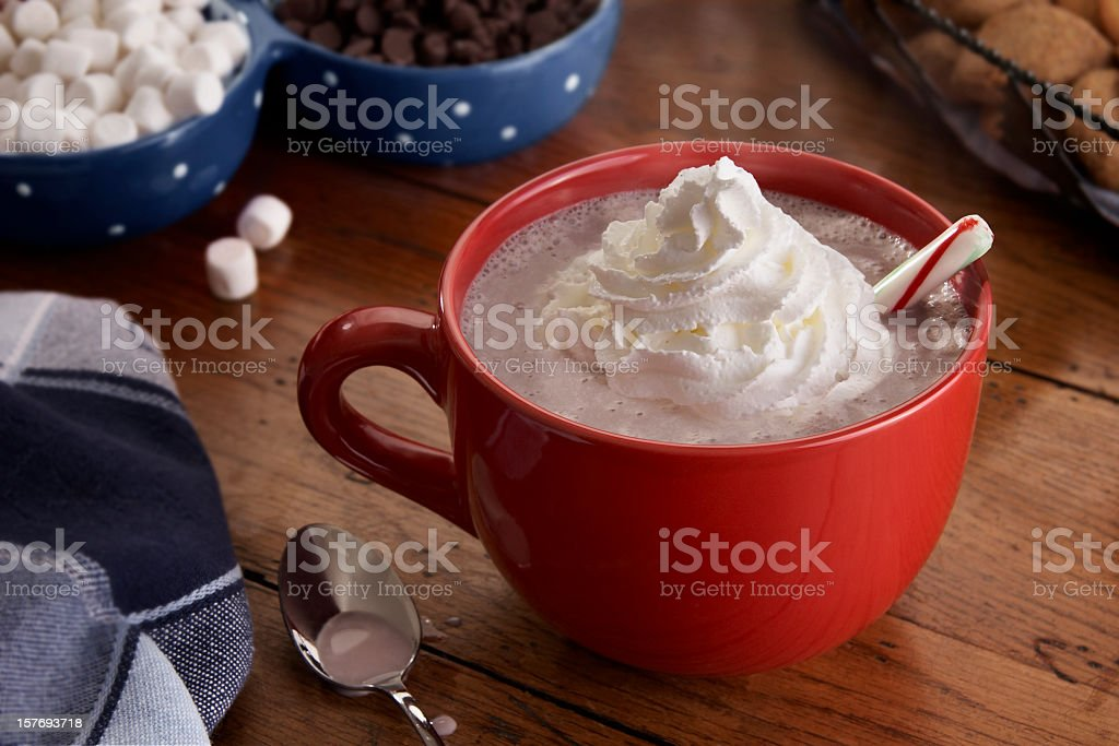 Mug of steamy Hot Chocolate and Whipped Cream stock photo
