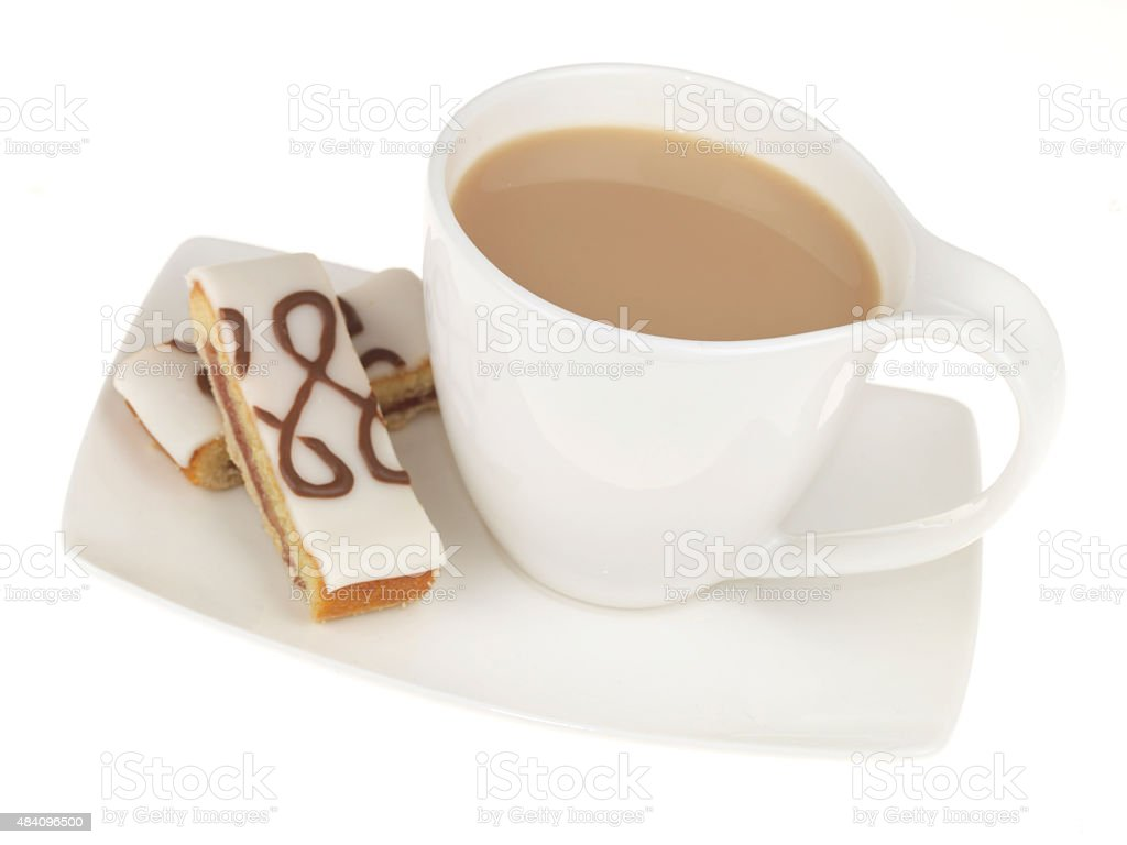 Mug of Tea and Iced Bakewell Cake stock photo