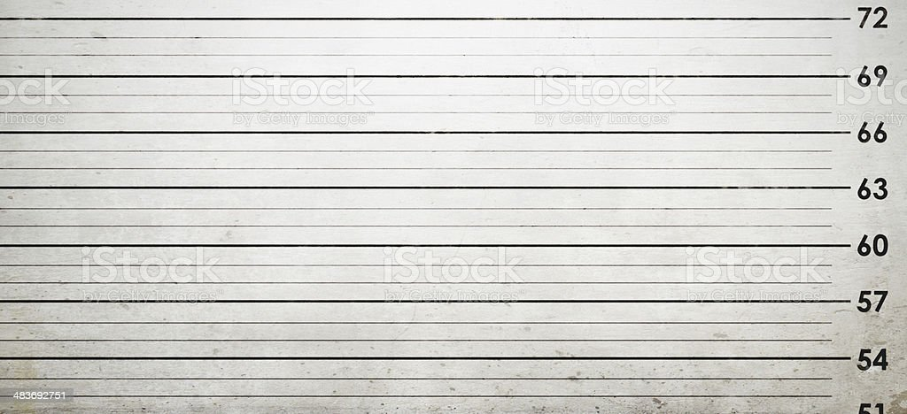 A standard police station background for measuring the height of...