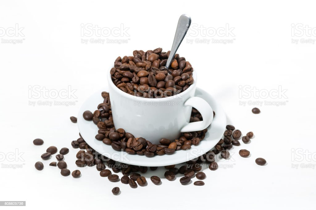 mug with coffee beans on white background, concept photo, closeup