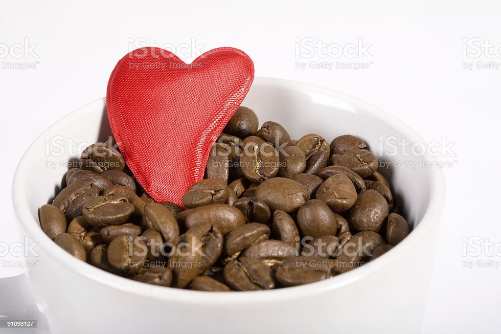 Mug with coffeebeans and heart royalty-free stock photo