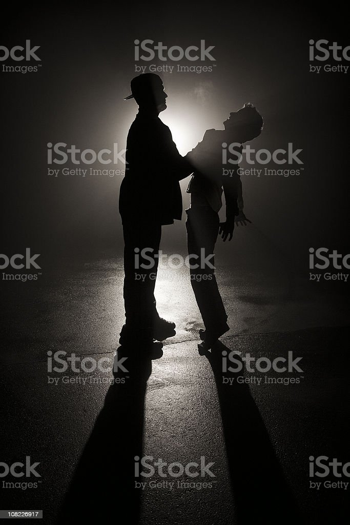 Mugged in the Shadows stock photo