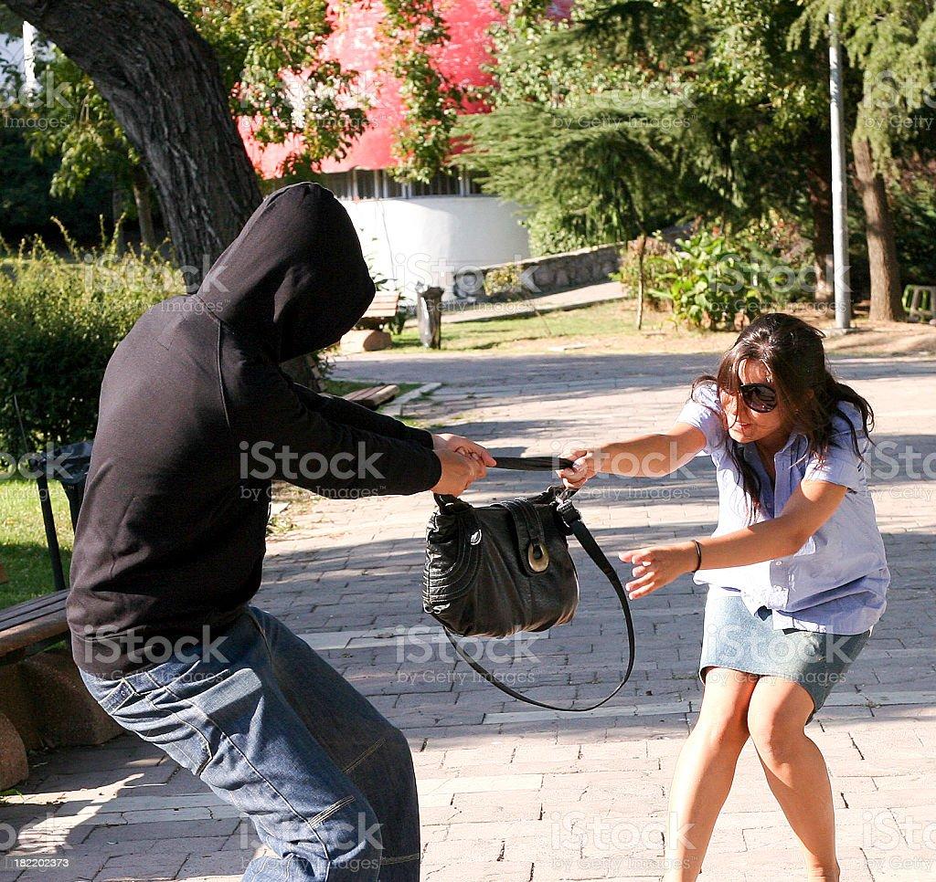mugger grabs the bag stock photo