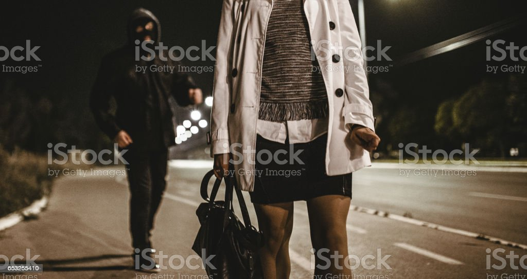 Mugger in action stock photo