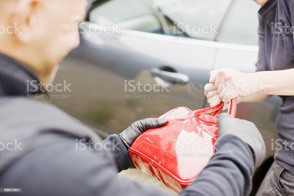 Mugger stealing handbag stock photo
