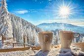 mugs and winter landscape