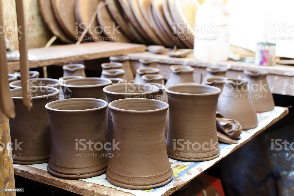 Mugs awaiting firing stock photo