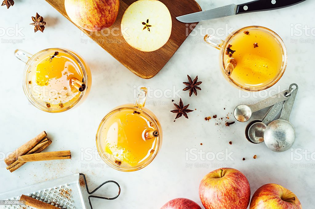 Mugs of Hot Spiced Mulled Apple Cider with Ingredients stock photo
