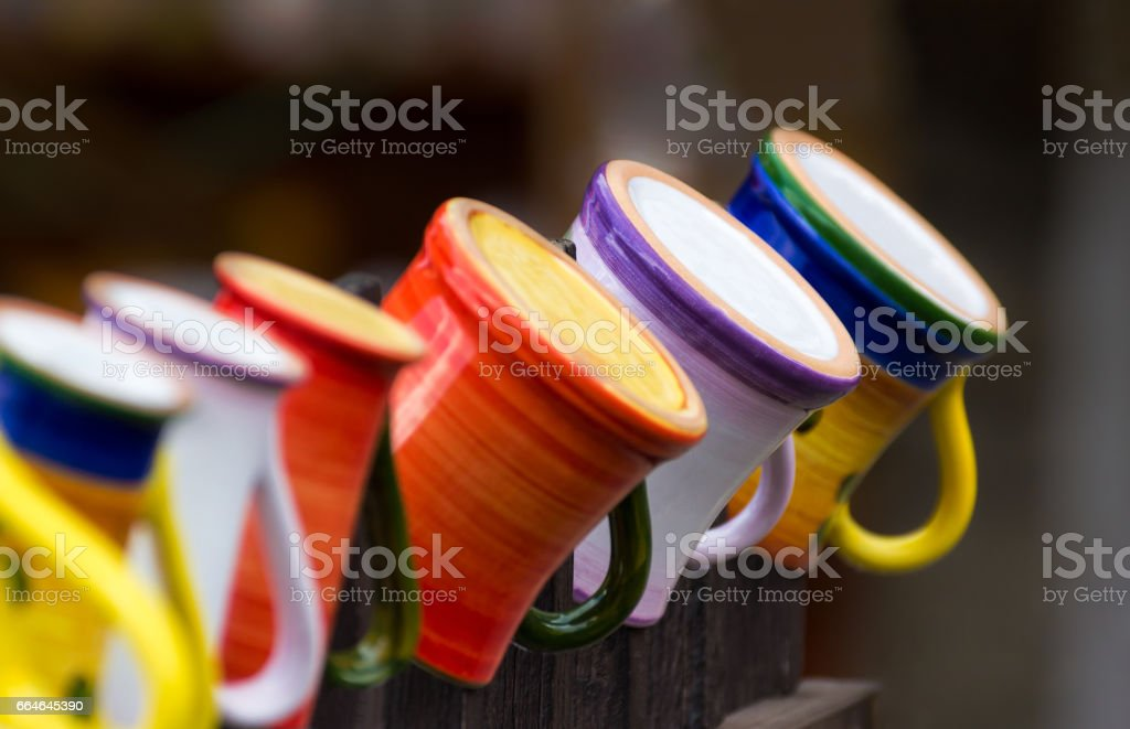 Mugs on wooden fence stock photo