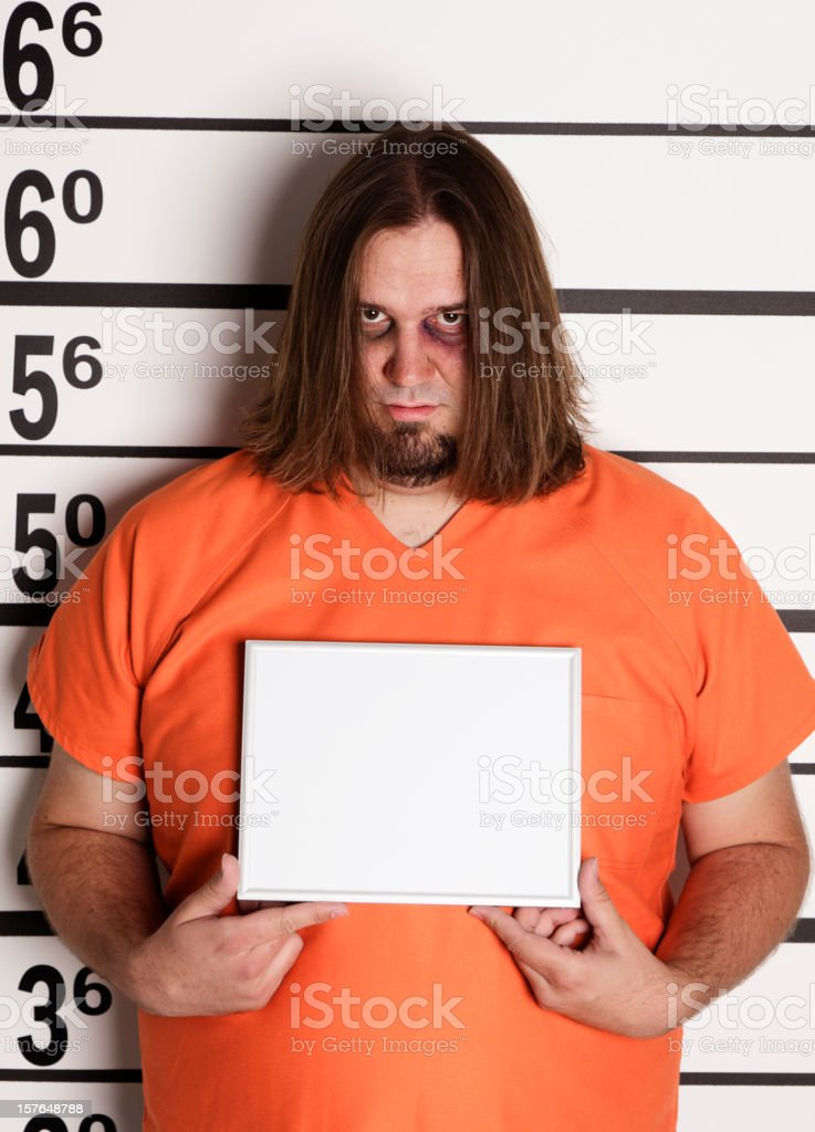Mugshot of a Large Man in Prison Uniform stock photo