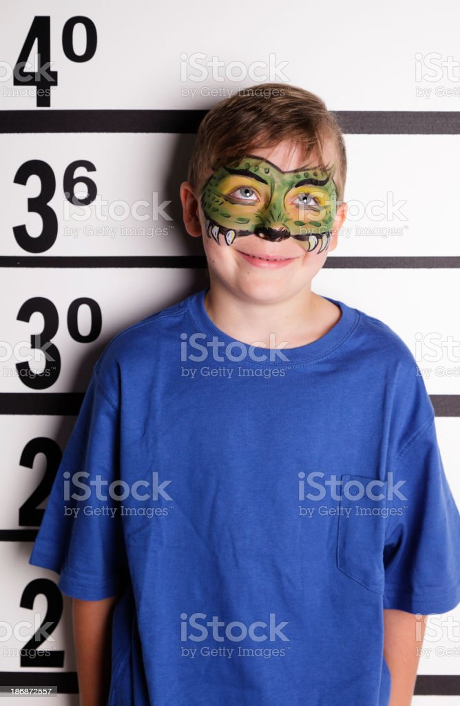 Mugshot of a Little Boy with Face Paint stock photo
