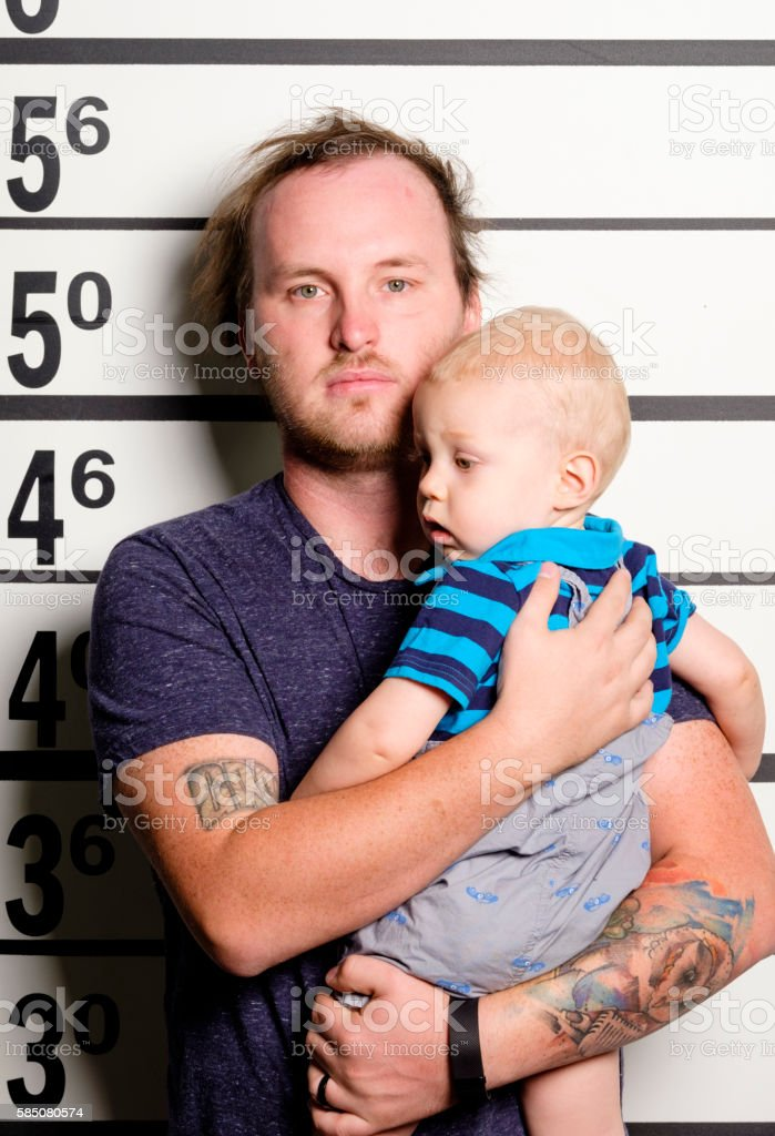 Mugshot of a Man and Baby stock photo