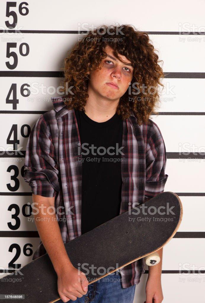 Mugshot of a Teenage Boy with Skateboard royalty-free stock photo