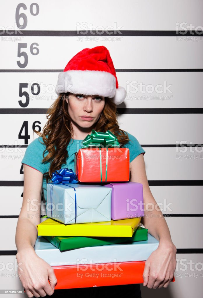 Mugshot of a Woman Holding Presents stock photo