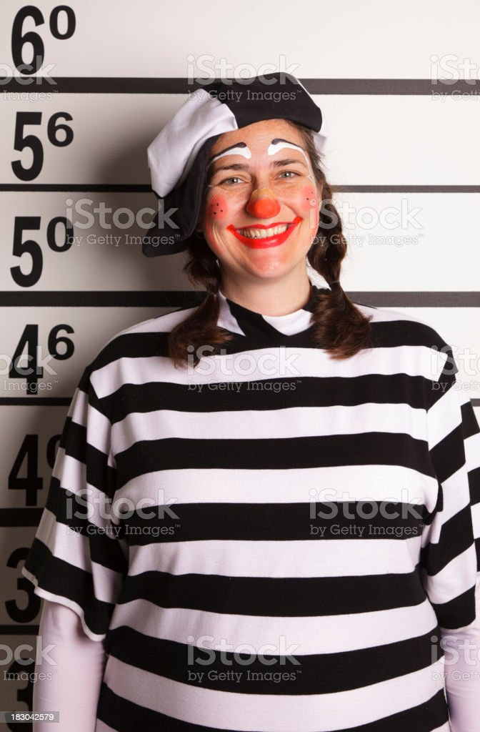 Mugshot of a Woman in Clown Costume stock photo