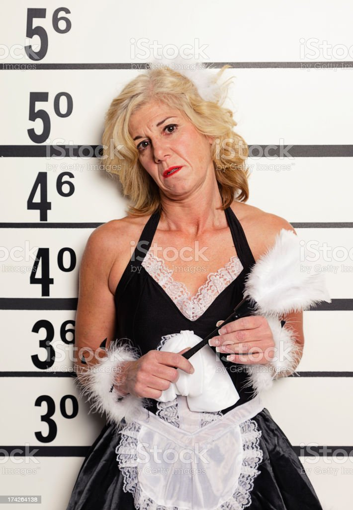 Mugshot of a Woman Wearing French Maid Outfit stock photo