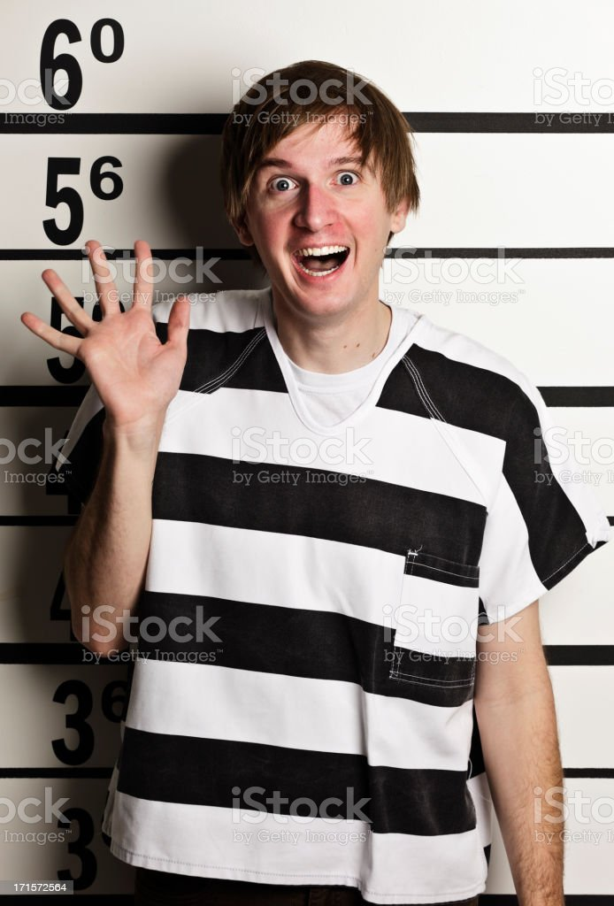 Mugshot of a Young Man in Prison Uniform royalty-free stock photo