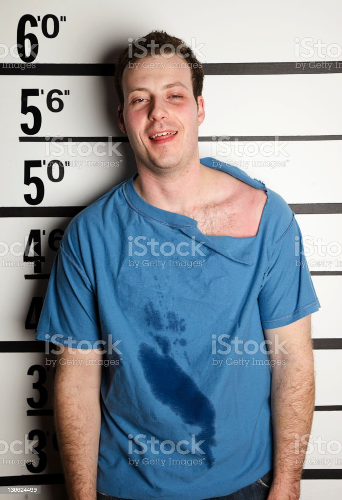 Mugshot of an Arrested Man royalty-free stock photo