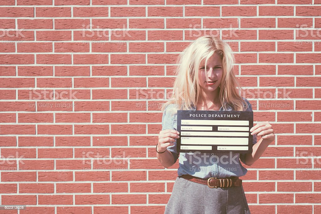 Mugshot of cute blonde woman stock photo