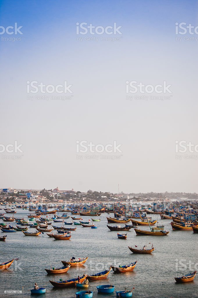 Mui Ne fishing village and traditional Vietnamese fishing boats stock photo
