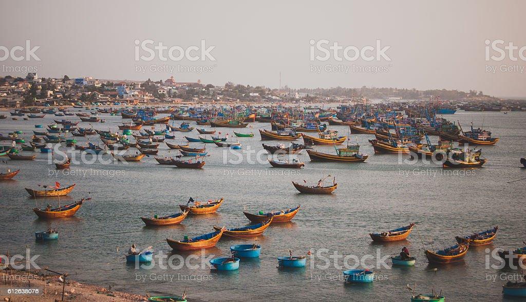 Mui Ne fishing village and traditional Vietnamese fishing boats stock photo