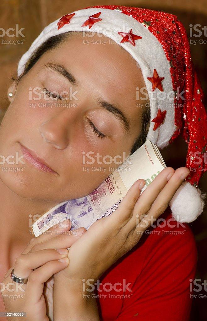 Mujer Papa Noel con Billetes stock photo
