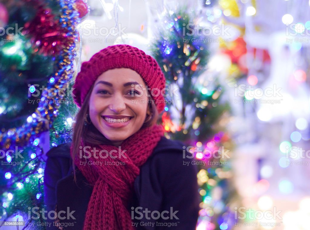 Mulato woman in front of christmas lights stock photo