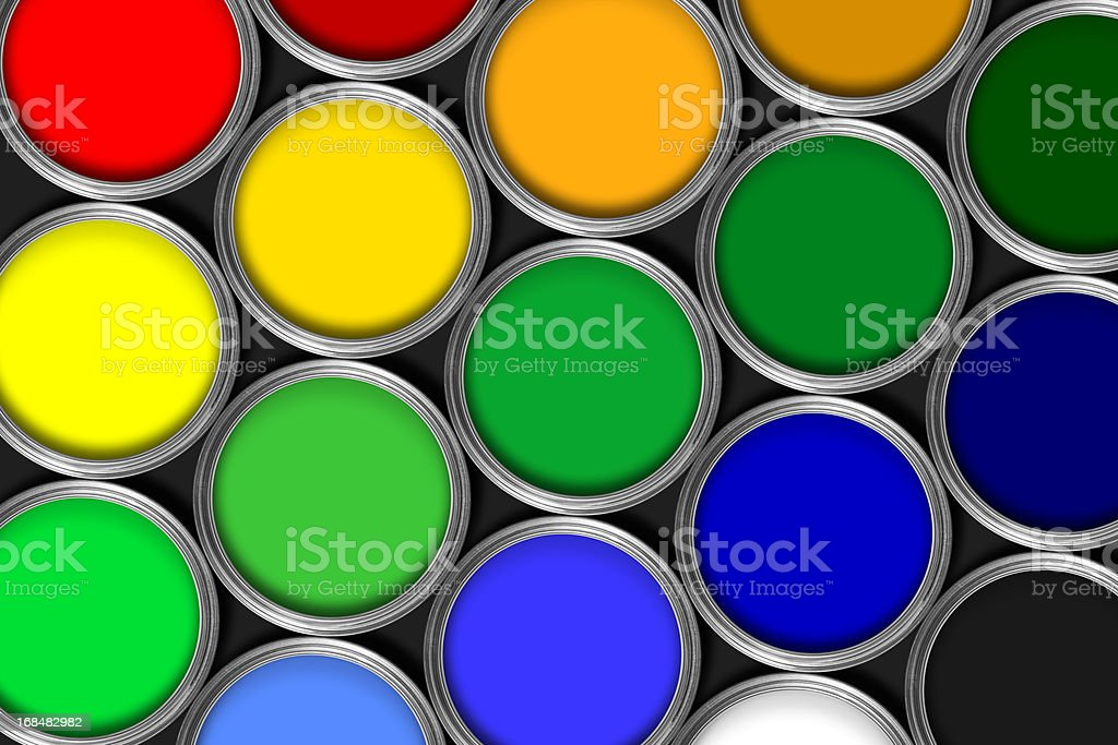 Mulit colored tins of paint in rows against black stock photo