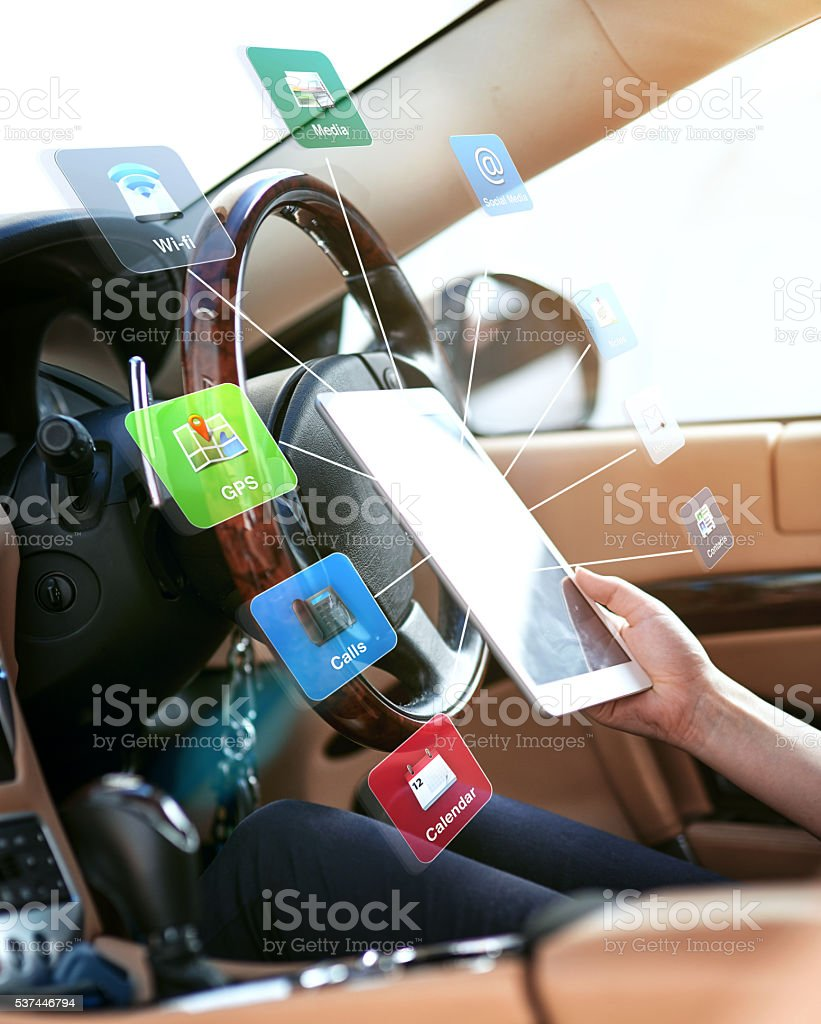 Mulit tasking in the driver's seat stock photo