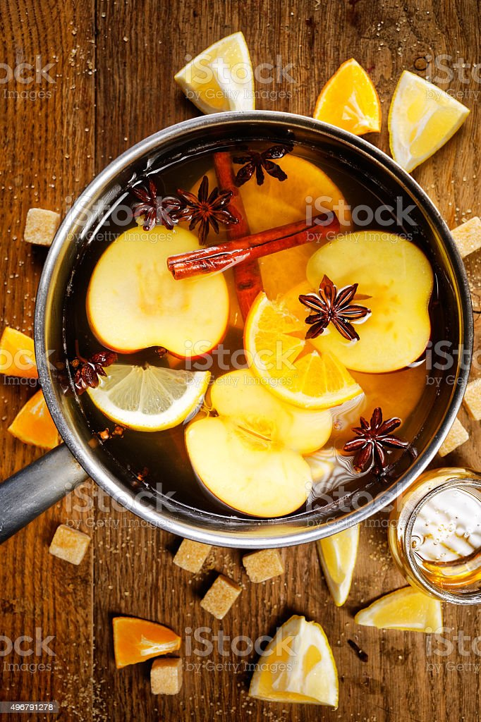 Mulled apple cider in a pot stock photo