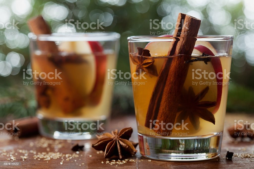 Mulled apple cider with spices cinnamon, cloves, anise and honey stock photo