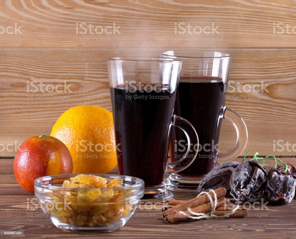 Mulled wine and fruits,spice on wooden background. stock photo