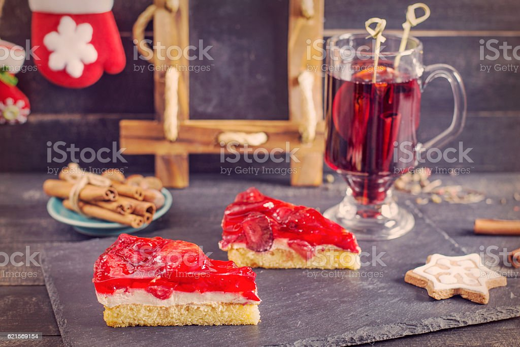Mulled wine and strawberry pie.Christmas decoration. Vintage design. stock photo