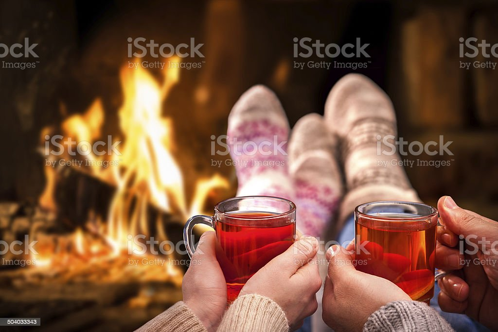 Mulled wine at romantic fireplace stock photo